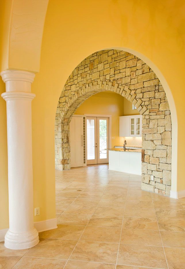 Rounded archway + stone accent wall | Living Room Ideas | Pinterest ...