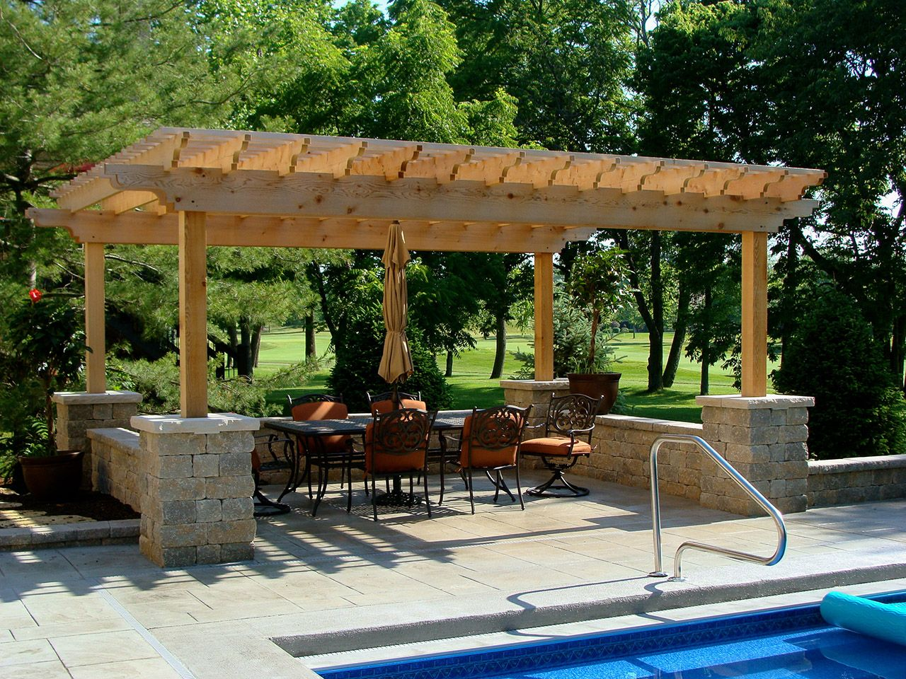 Stone Pergola Pillars And Gray Pool Patio
