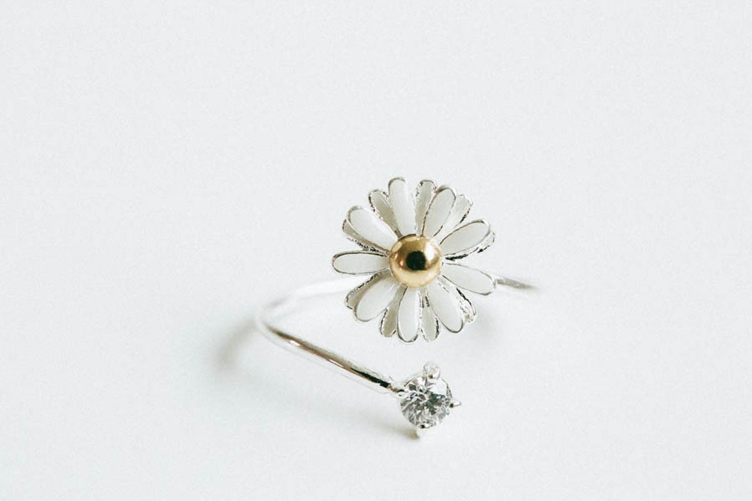 Cz daisy flower ring romantic jewelry gifts flower jewelry cz daisy flower ring romantic jewelry gifts flower jewelry available in silver gold or rose gold this stainless steel jewelry is sure to beco izmirmasajfo Image collections