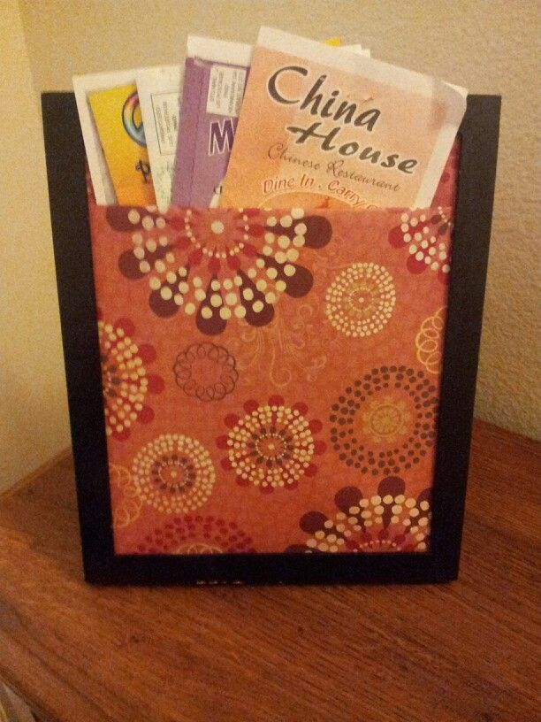 My new take out menu stand. A frame and some scrapbook paper... perfect!