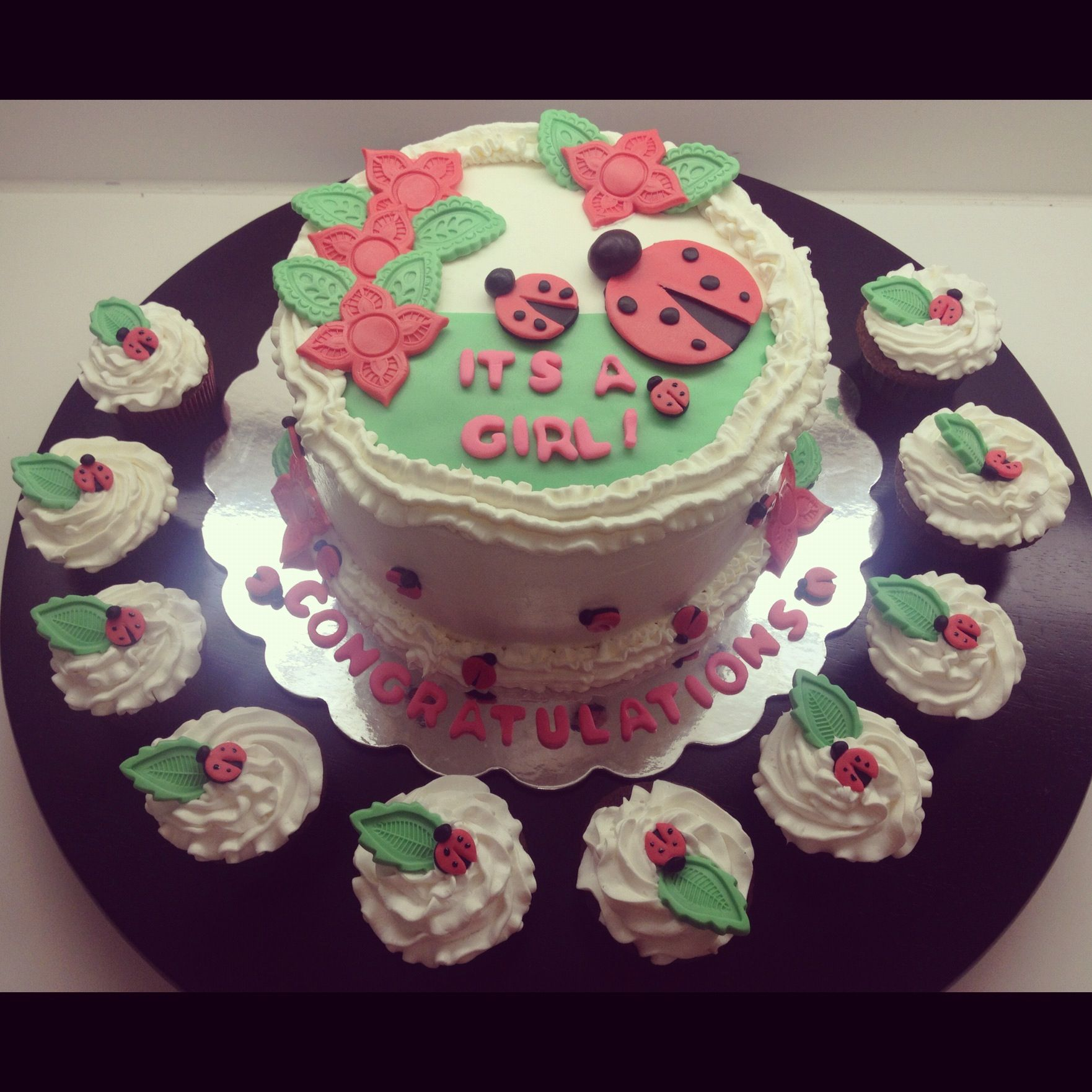Ladybug baby shower cake and cupcakes