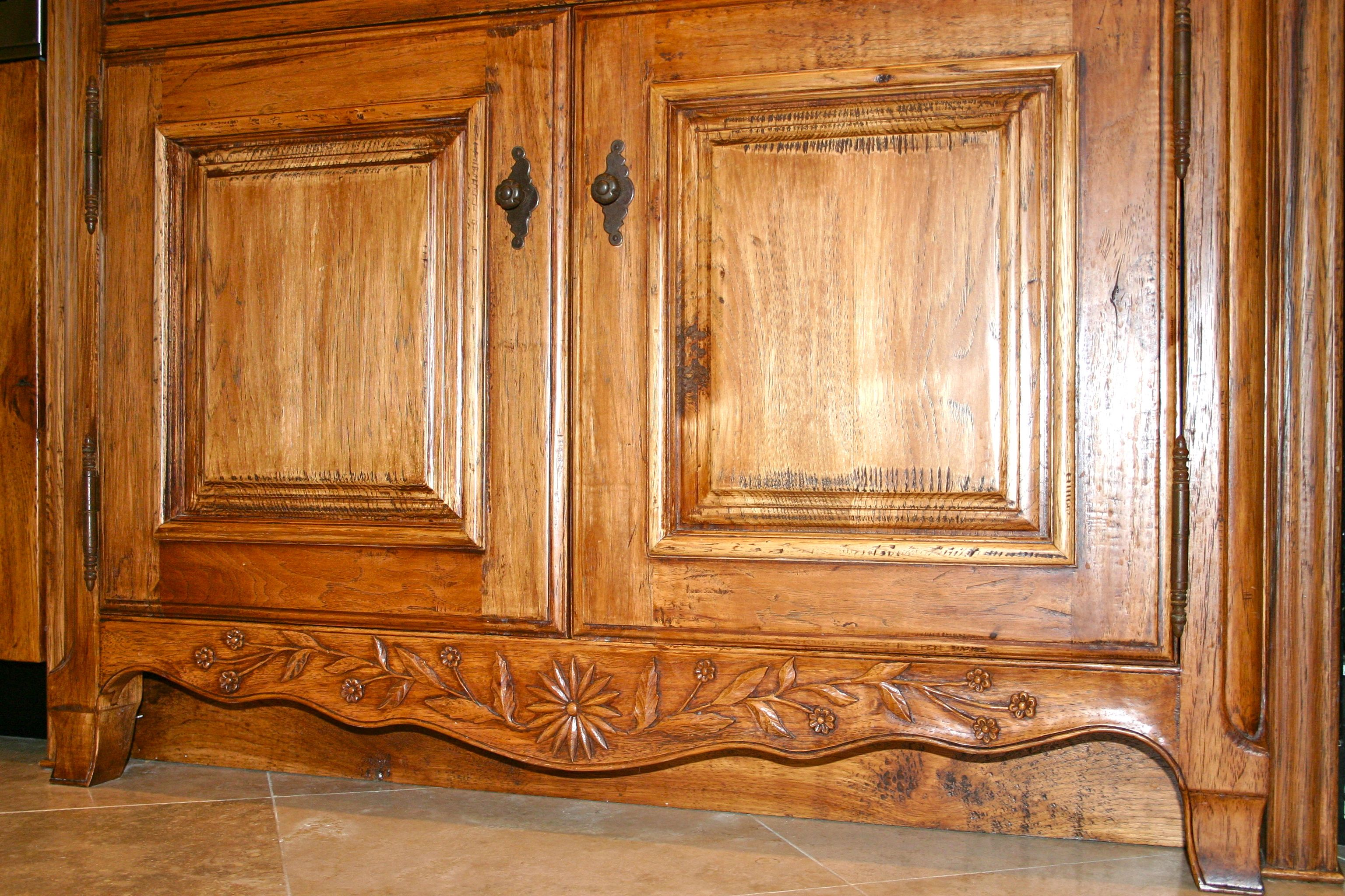 Close Up Of Hand Carving Flowers On Kitchen Cabinet Country French Kitchen With Hand Carved Details French Country Kitchens Built In Cabinets French Kitchen
