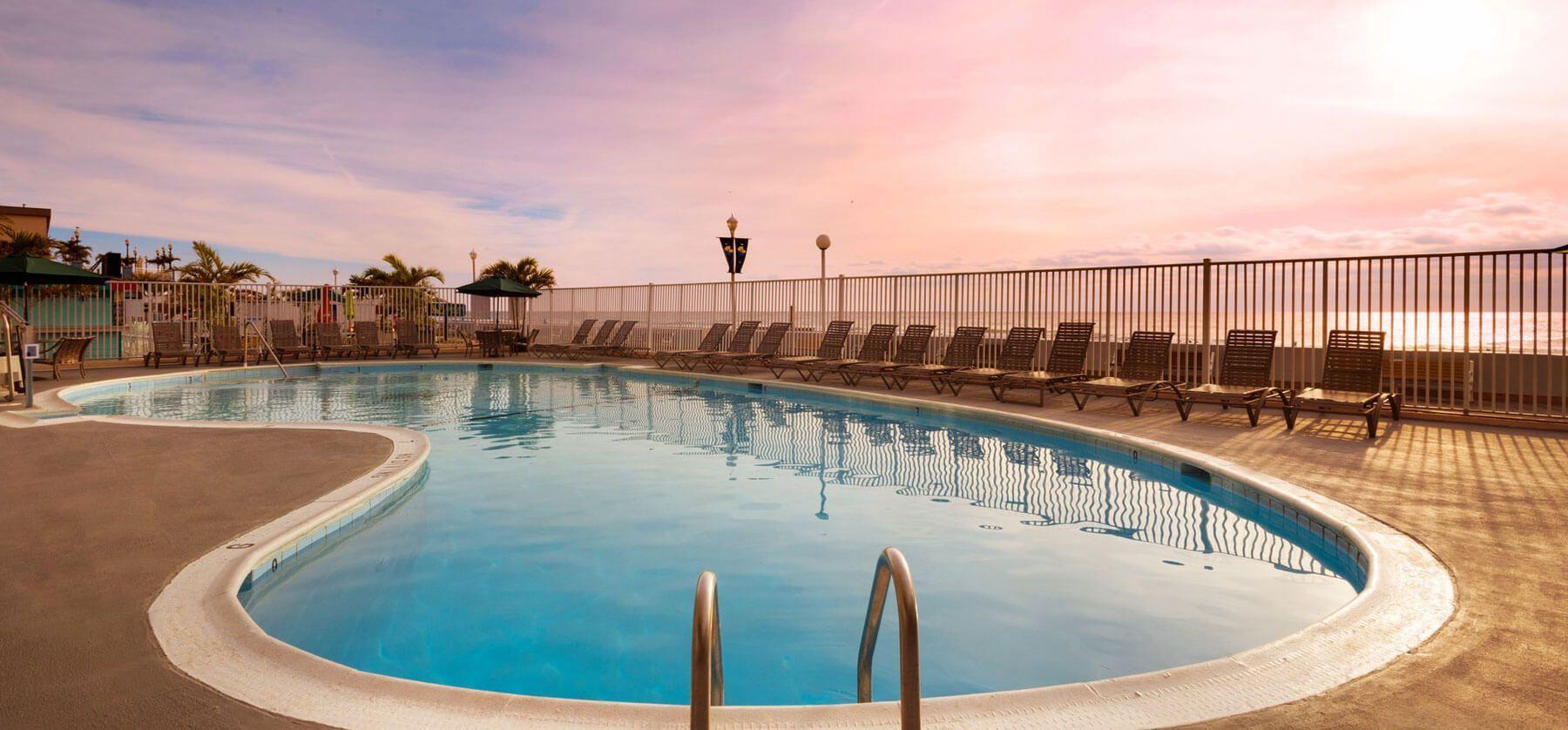 Watch The Sun Rise Over The Beach In Ocean City At The Quality Inn Boardwalk Pool Ocmd Ocean Ocean City Maryland
