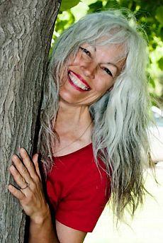 Long silver gray hair. Mature and aging gracefully. Grey hair. Granny hair. No dye. Dye free.