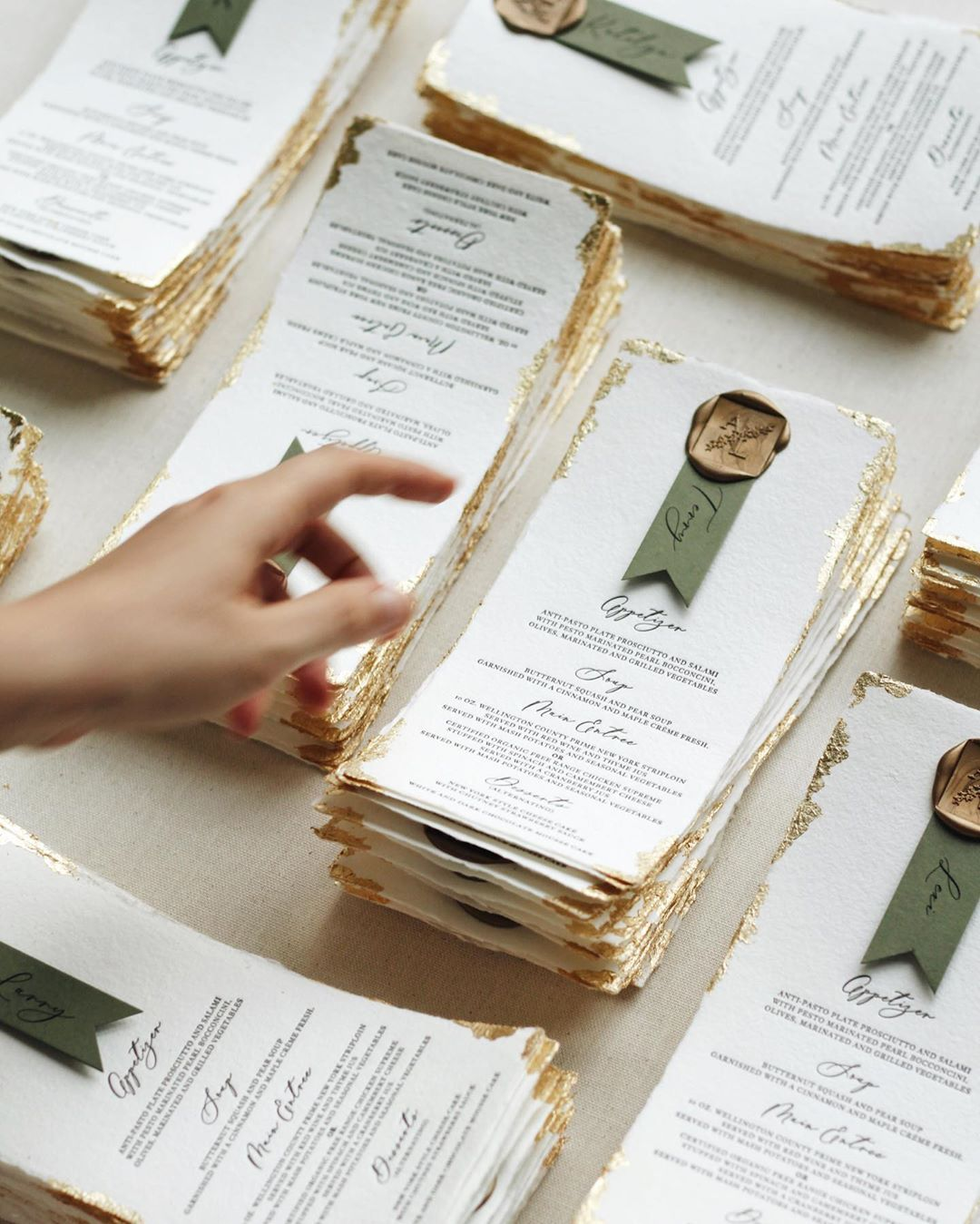 Wedding menus with name cards and wax seal printed letterpress on handmade paper + gold leaf edges