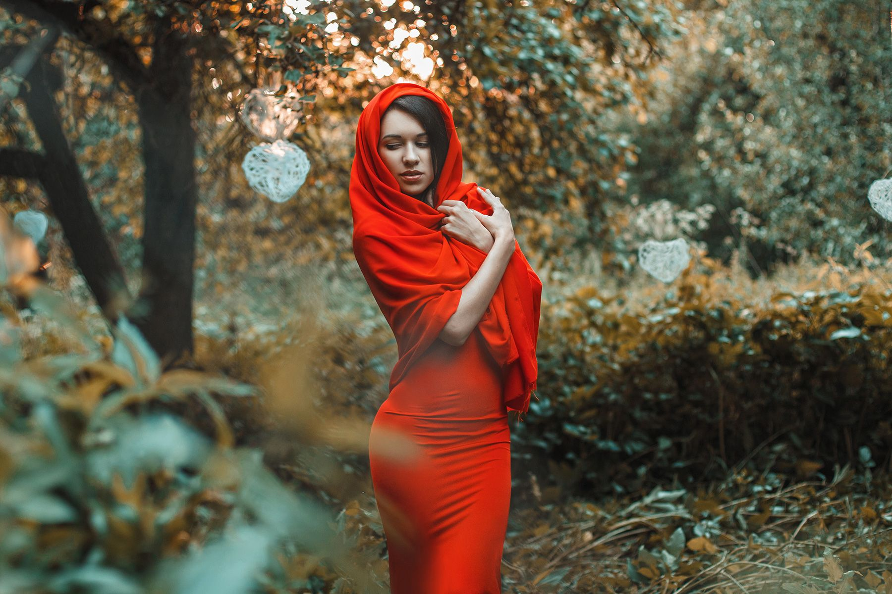 Portrait of a beautiful girl in a red dress. Fable.