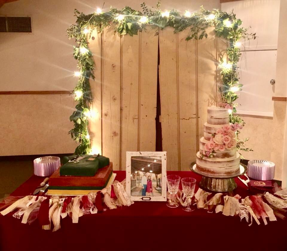 Macy Brennen S Wedding Bride And Groom Cake Table With The Backdrop Grooms Cake Tables Wedding Cake Table Wedding Reception Backdrop