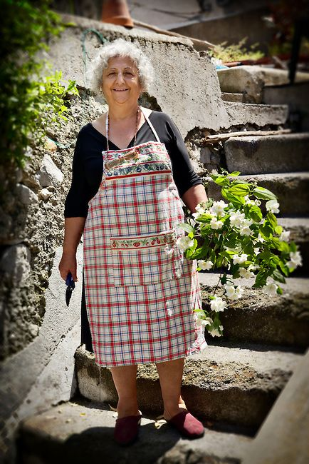 Woman in a garden with flowers in Amalfi, Italy.