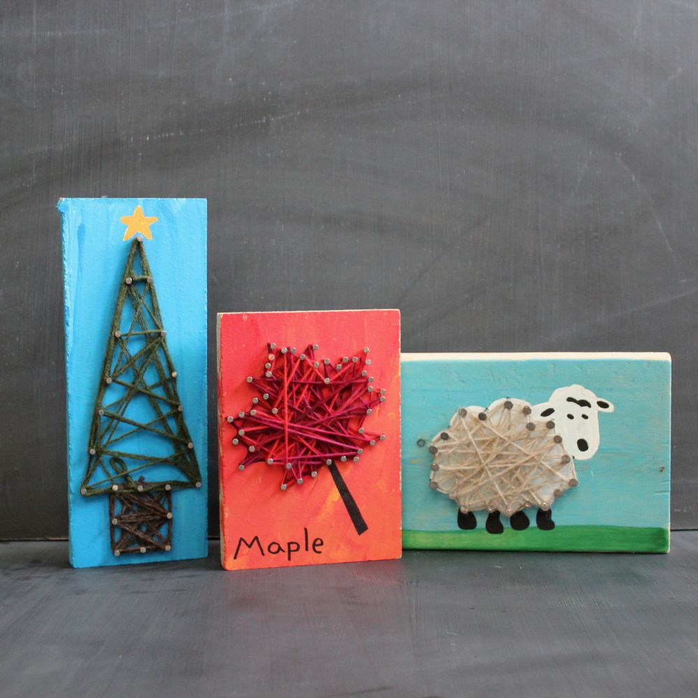 using a wood block, make a picture, hammer nails around
