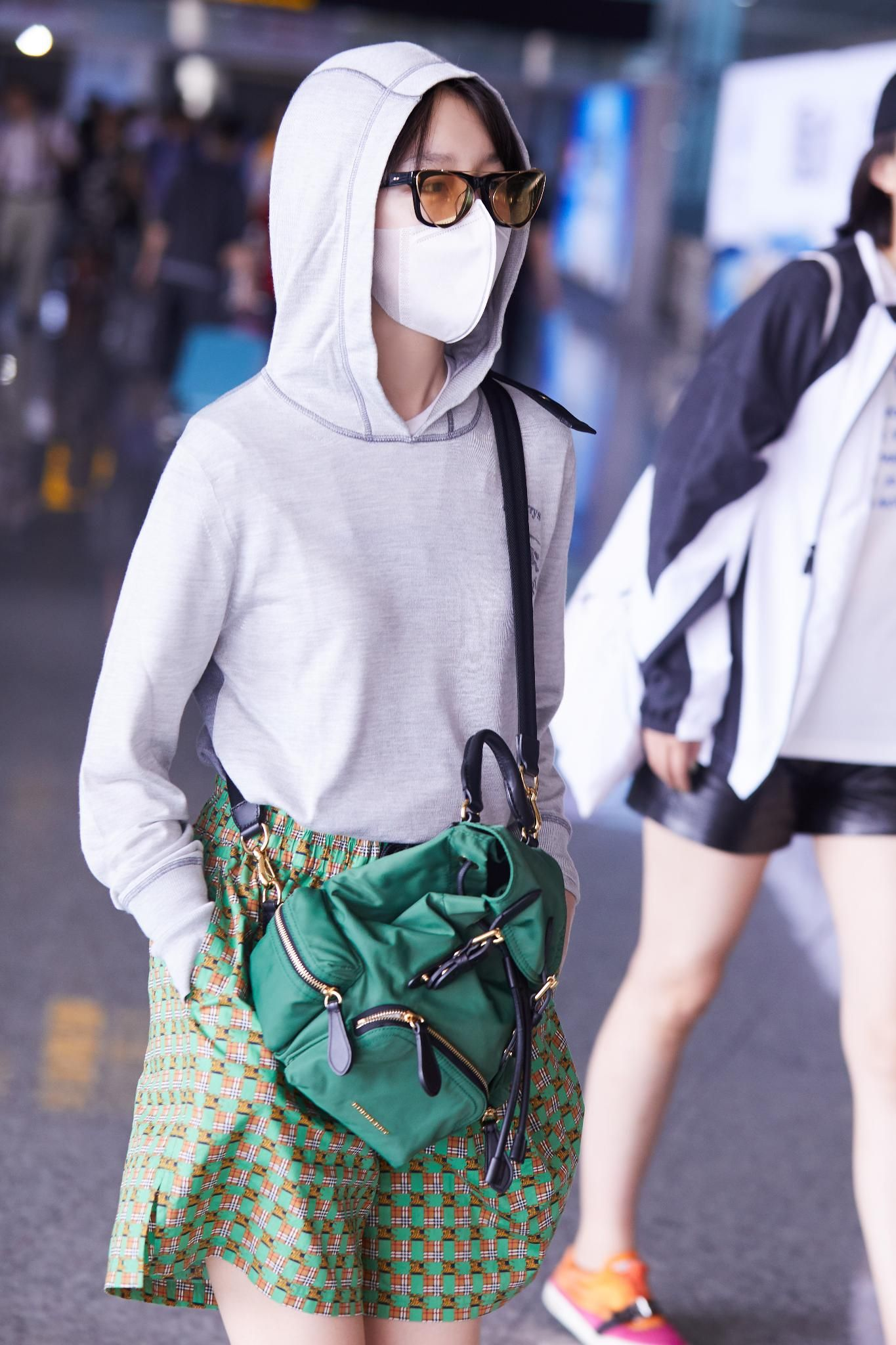 f575df5775e36  ZhouDongyu wears a  Burberry embroidered silk hoodie with check print  shorts and the small crossbody rucksack at Chongqing airport