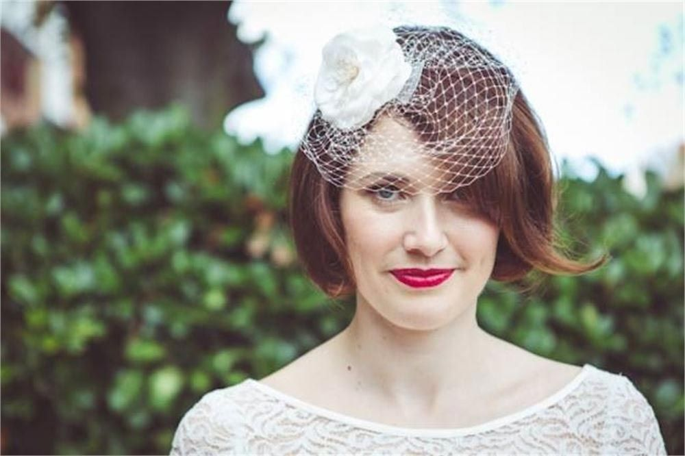 Bride with a short simple wedding hairstyle and birdcage veil ...