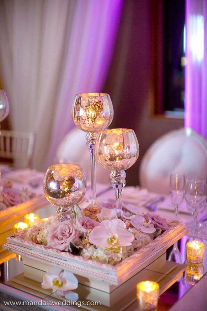 Cracked glass goblets and photo frame tealights