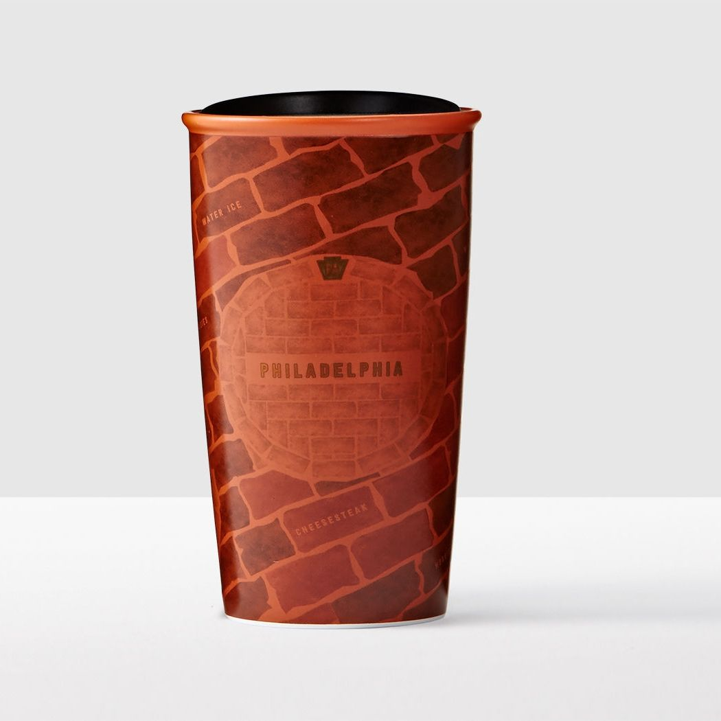 A double-walled ceramic mug with art inspired by the brick-paved streets and row homes of Philadelphia.