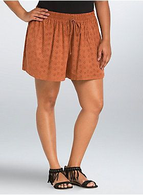 "<p>Fit for a dazed and confused kind of gal, these shorts are lighting our fire and then some. Silky soft rust-hued faux suede covers the smocked waist design (yes, the snuggle is real on these, especially with the adjustable drawstring waist). The perforated design has you looking and feeling experienced.</p>  <ul> 	<li>Size 1 measures 3 1/2"" inseam</li> 	<li>Polyester/spandex</li> 	<li>Wash cold, line dry</li> 	<li>Imported plus size shorts</li> </ul>"
