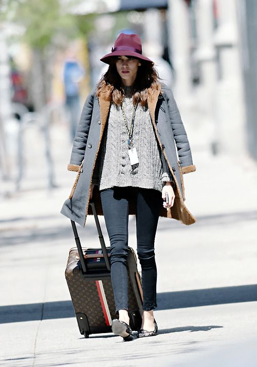 Alexa Chung seen wearing red sun hat and floral print flats while carrying luggage in NYC - April 28,2013