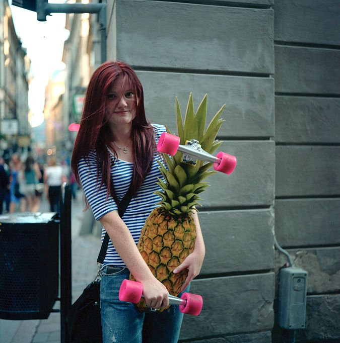 Girl with a pineapple skateboard