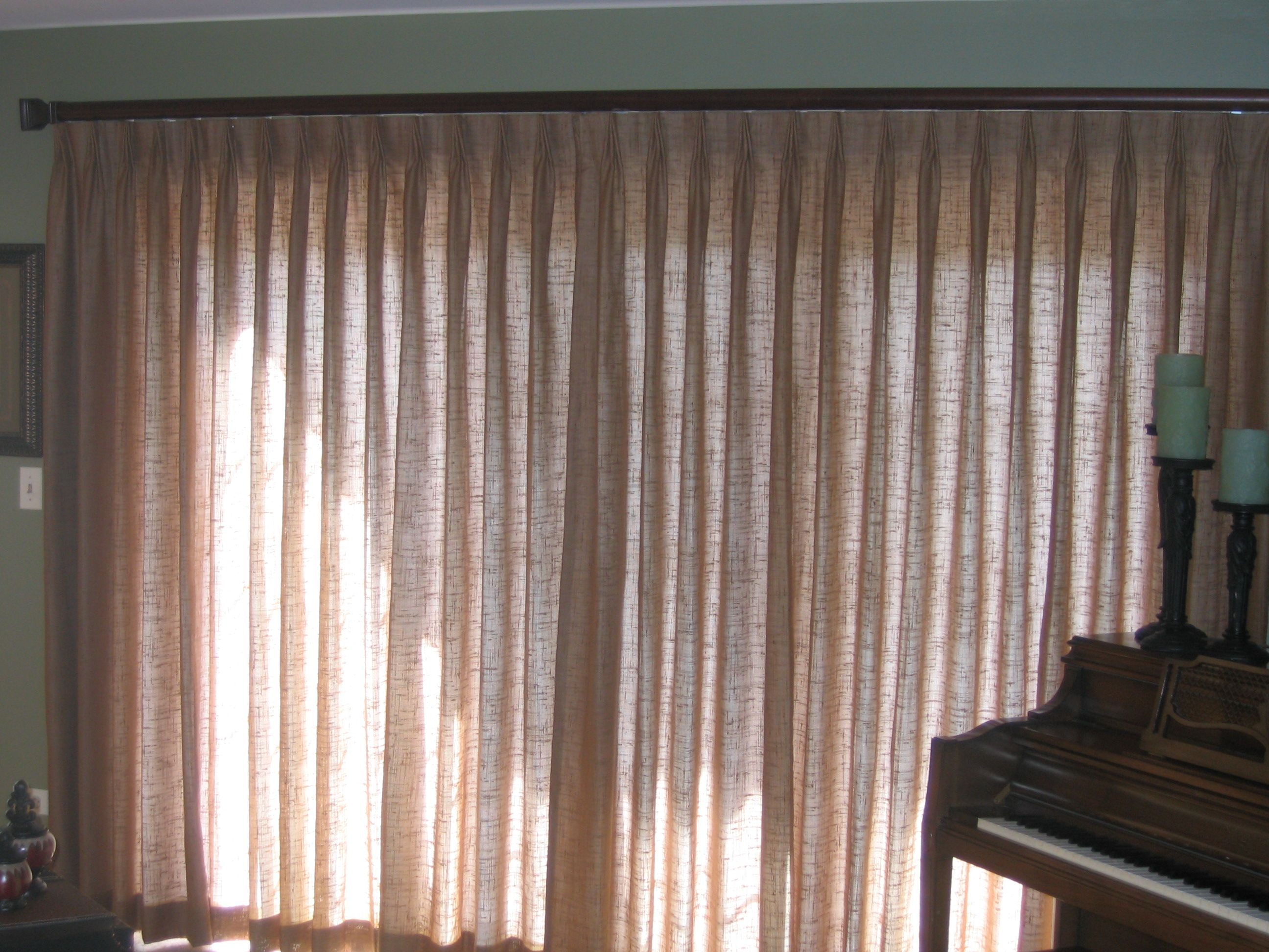 Pinch Pleat Drape On A Sliding Glass Door With A Decorative Traverse