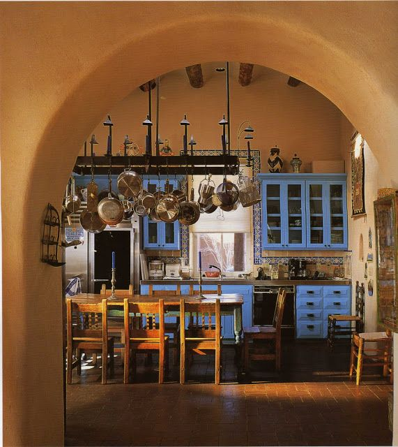 Hacienda cocina...Ooh ooh ooh  I could do this to my kitchen and dining room.  I have arched doorways and tall wooden cabinets