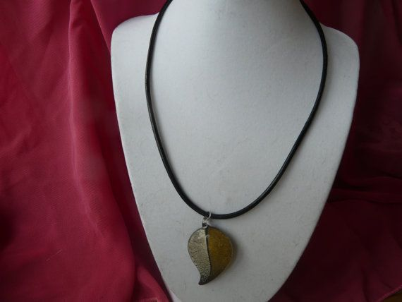 Gold and silver leaf pendant on a leather by GilliansJewellryBox, $12.00