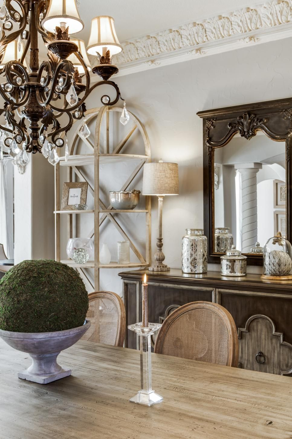 A Farmhouse Style Dining Table Pairs With An Elegant Brown Buffet