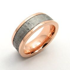 #Rose #Gold #Meteorite #Ring has a naturally occurring pattern, like a fingerprint, which means each ring is a one of a kind. This one is inlaid into recycled 14k rose gold, the edges are flat and it has a high polish finish. The meteorite fell in Namibia during prehistoric times. This ring measures 8mm in width.   #DnH #Sustainable #Jewelers