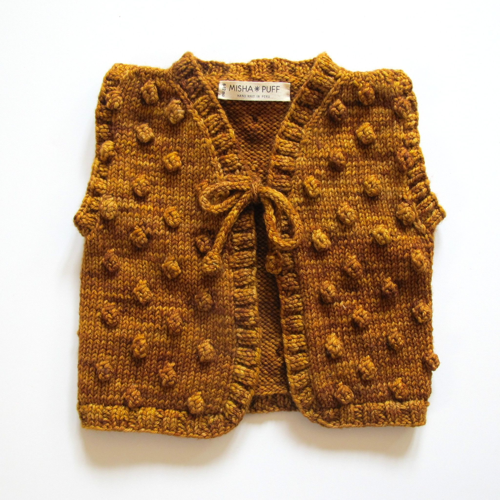 Sweet little vest in our signature popcorn stitch. Wear over everything. From our Popcorn Collection: The MP classic overall popcorn stitch pattern. Hand knit in Peru. 100% hand dyed merino wool. Mach