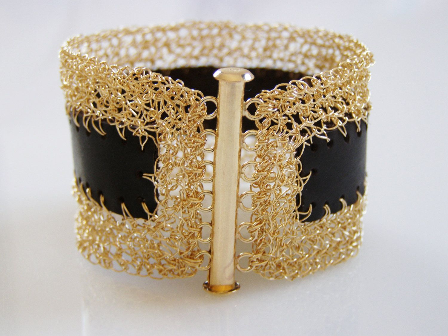 Bracelet...a combination of crochet gold filled wire and leather