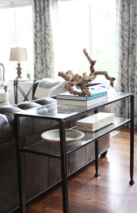 suzie: jana bek design - living room with iron glass-top console