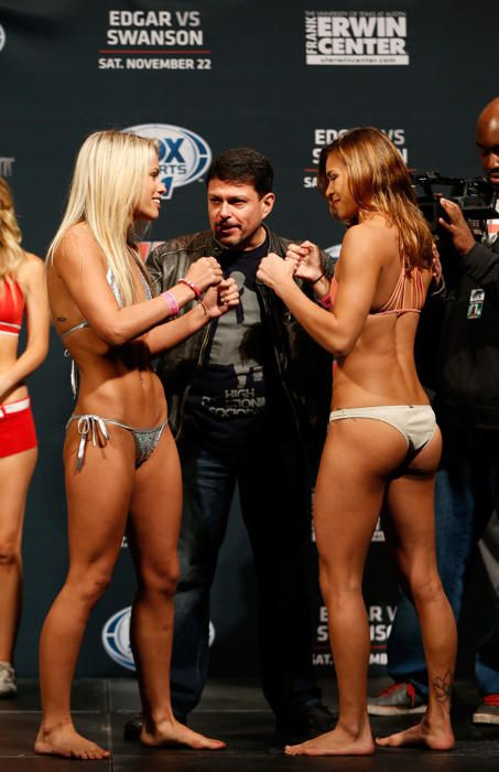 Badass women! (L-R) Opponents Paige VanZant and Kailin Curran face off during the UFC weigh-in at The Frank Erwin Center on November 21, 2014 in Austin, Texas. (Photo by Josh Hedges/Zuffa LLC/Zuffa LLC via Getty Images)