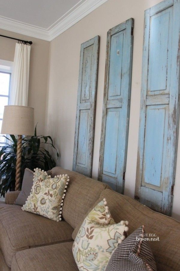7 Inspiring Ways To Use Vintage Shutters On Your Walls Brown Living Room Decor Brown Living Room Brown And Blue Living Room #vintage #living #room #wall #decor