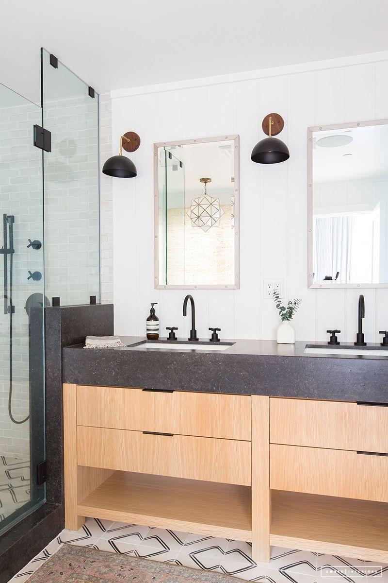 floor tile and wide stone countertop skirtvanity  amber