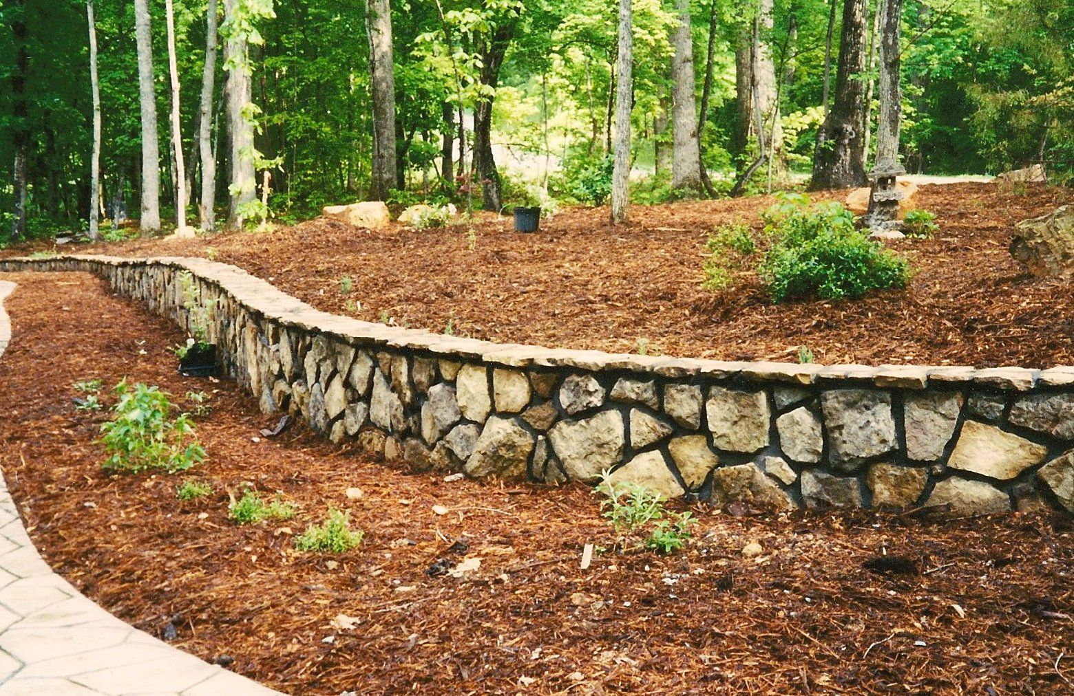 Stone wall ideas with mountain rocks also combine with for Outdoor retaining wall ideas