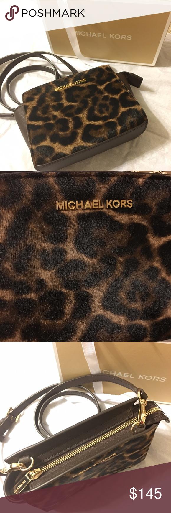 8c912e45ff57 michael kors haircalf selma mini cross body Glossy leopard print calf hair  gives this sporty MICHAEL