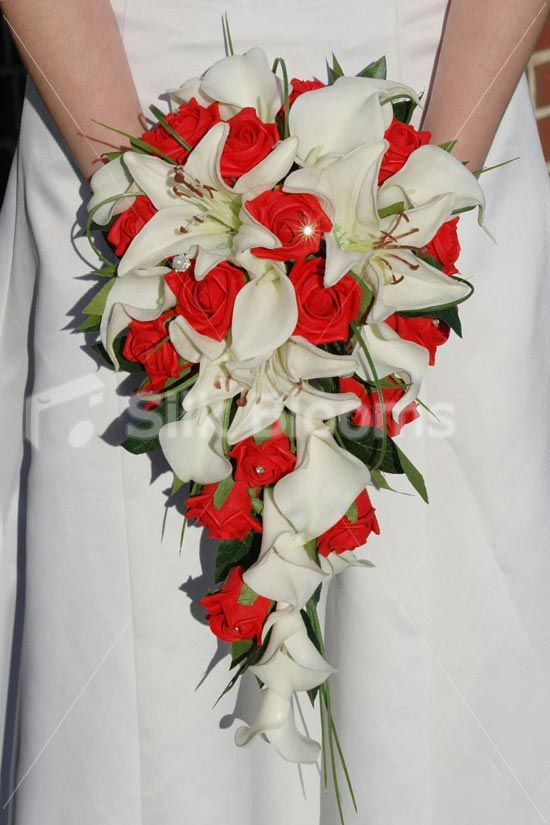 This White And Red Cascading Bridal Bouquet Is Made With Realistic Fresh Touch Oriental Lilies