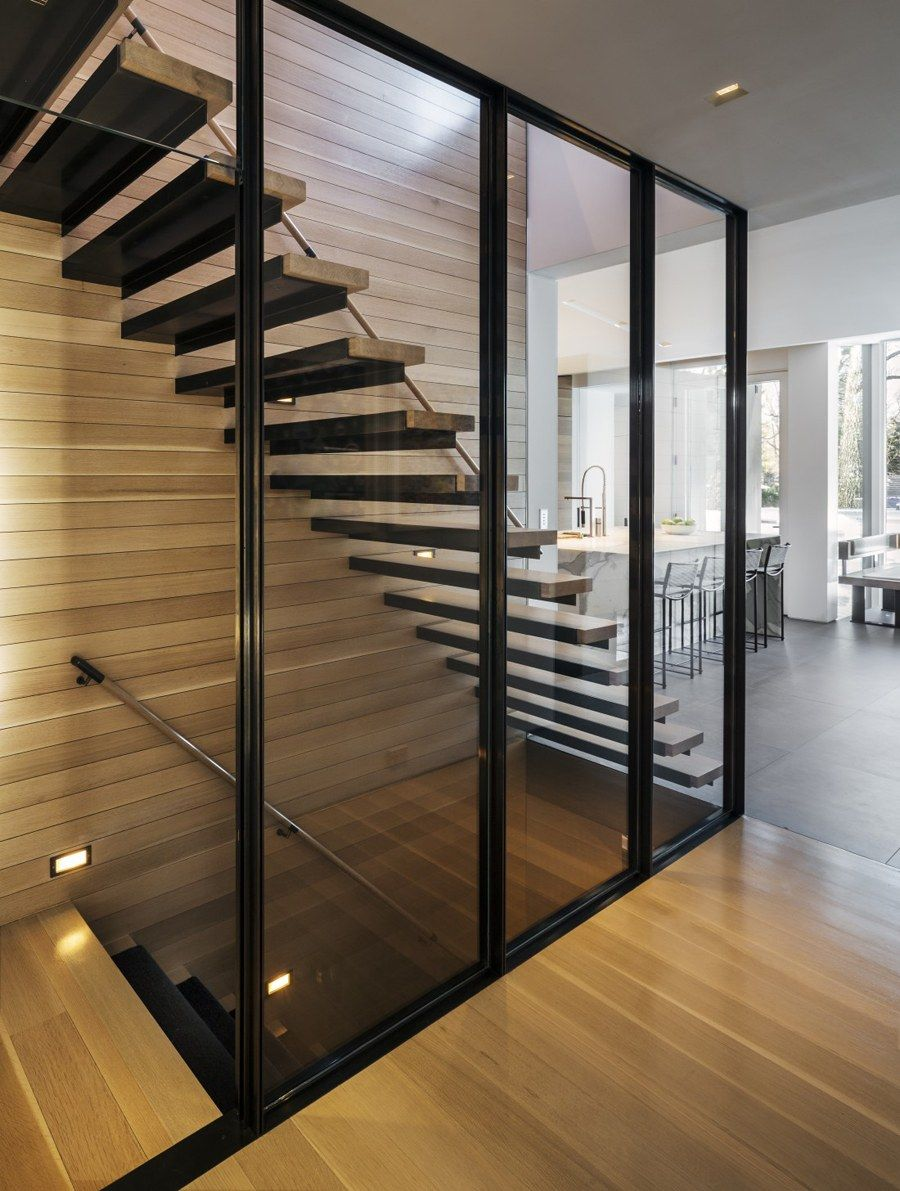 Stairs in a Modern Tudor by Monica Fried Design | Photo by Esto Photographers