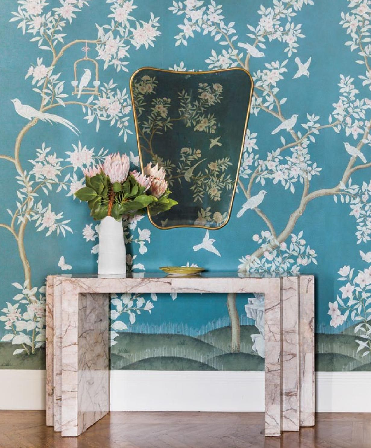 Blue Flower Wallpaper with Unique Gold Mirror and Console Table