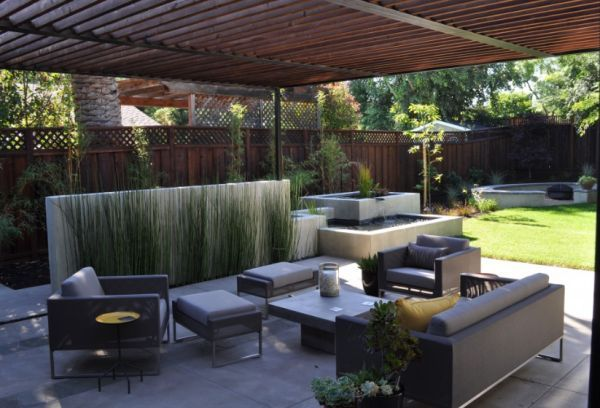 Concrete Water Feature And Low Focal Point Wall With Plants · Modern Patio  ...