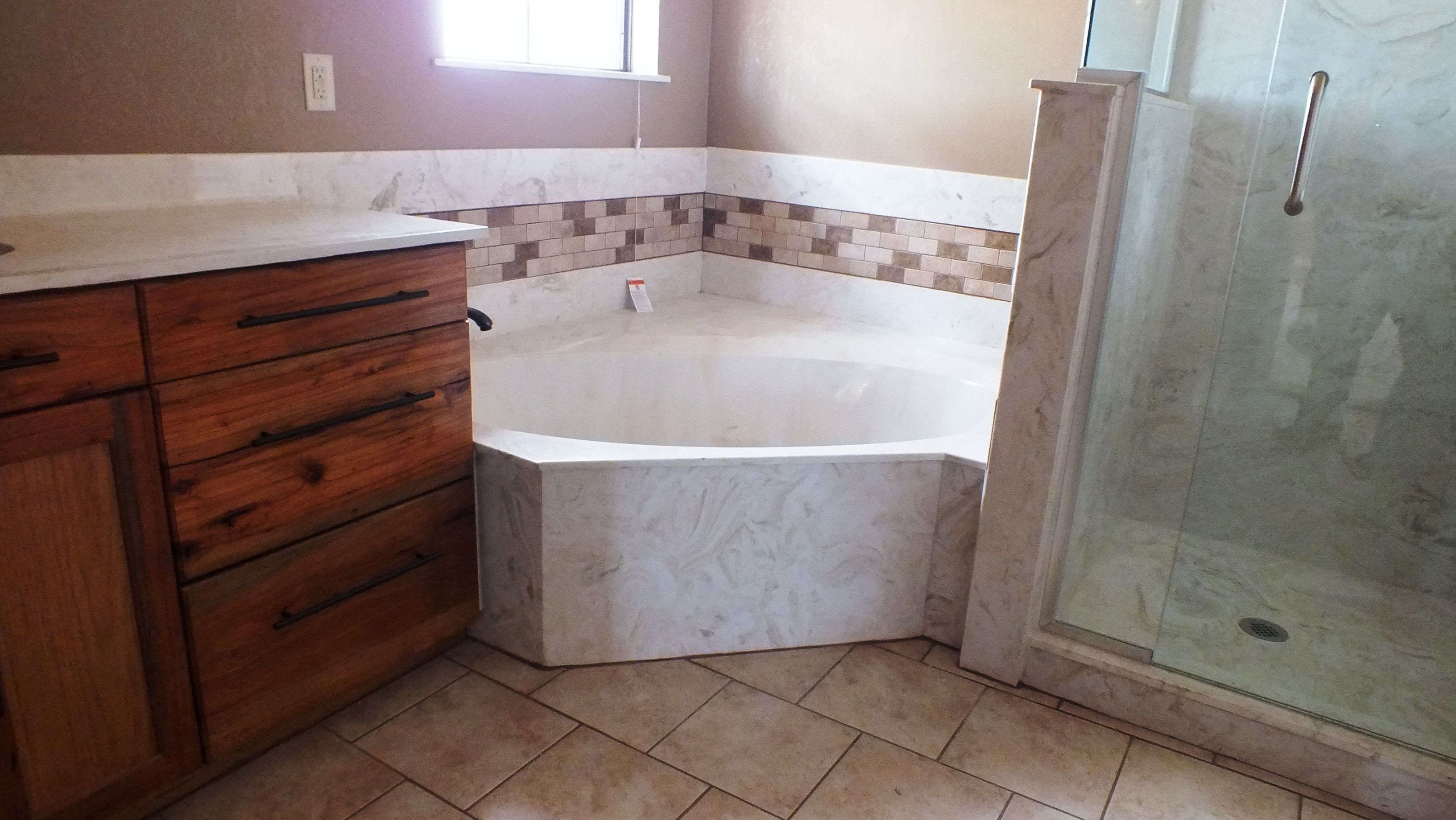 Our Custom Burnt Almond Corner Spa Tub With 6 Jets Heater Spa Pump Bubbler Our Spa Tub Is Finished With A Custom Ma Vanity Sink Custom Shower Marble Design