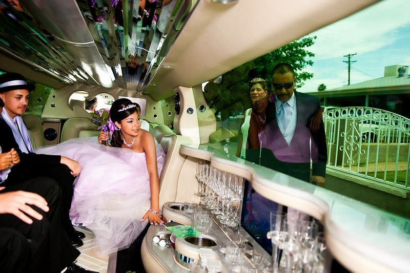 Quinceanera photography -- looking out the limo window  at mom and dad