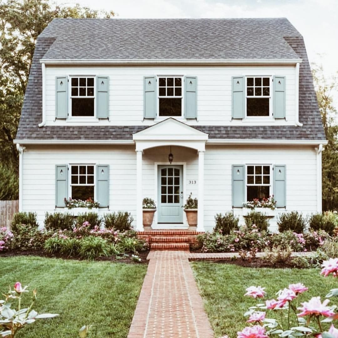 Symmetrical This Cottage Exterior Is Balanced With Its Windows On Both Sides And The Shutters Add Focal Points Color Contrast To Neutral White