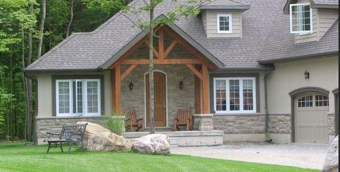 white windows dark gray trim greige stucco timber accents