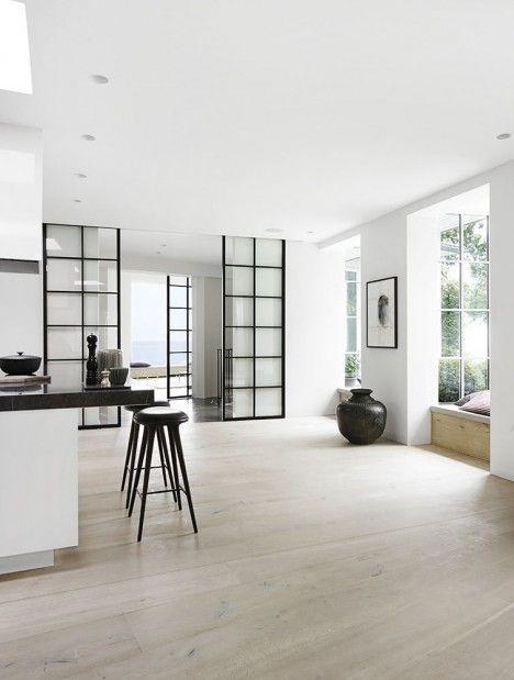 Internal sliding glass doors on a hillside villa - Living room sliding doors interior ...