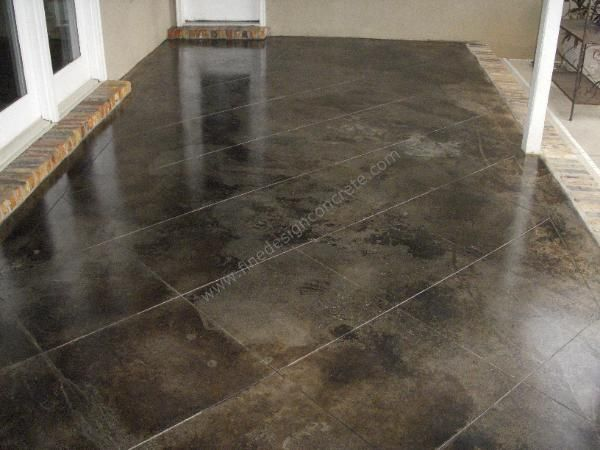 Living room flooring stained cement tile wood flooring for Black stains on concrete