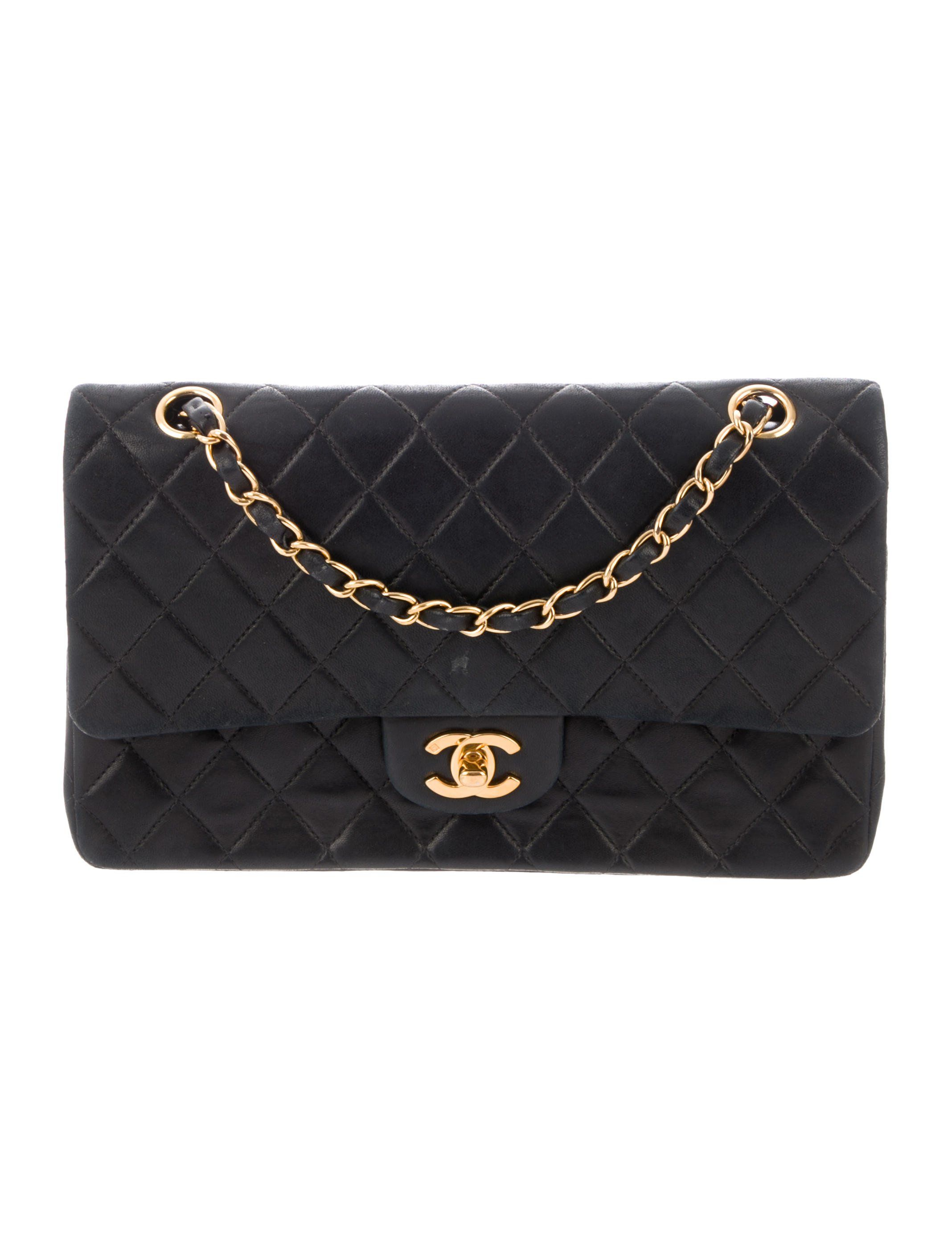 32d41643e67a Black quilted lambskin Chanel Medium Double Flap bag with gold-tone  hardware, convertible chain