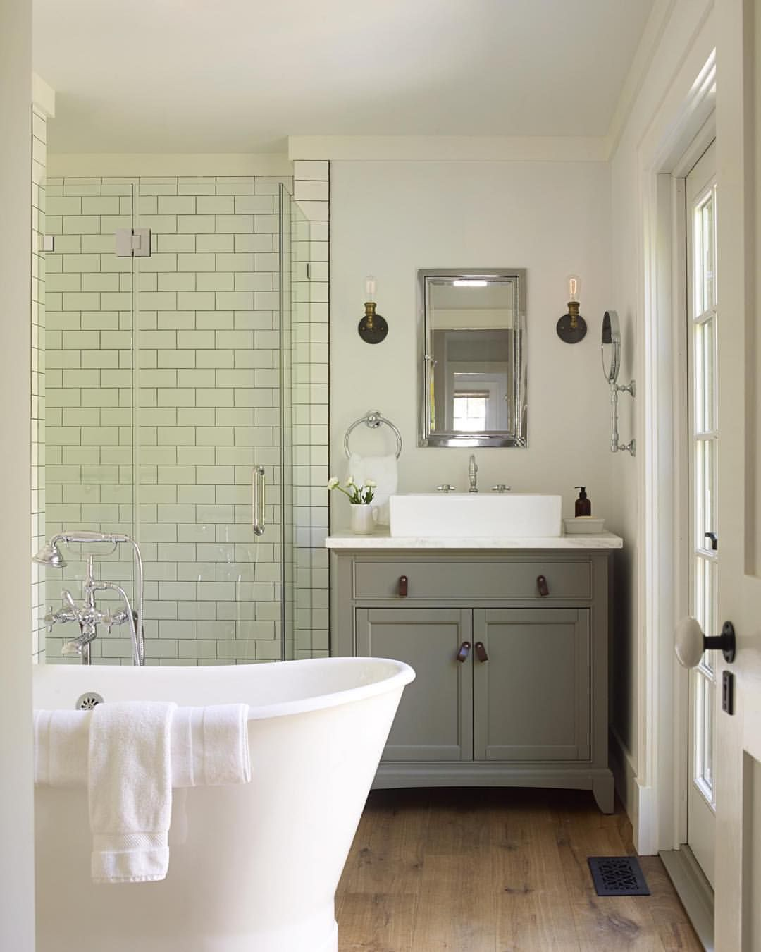 Metro tiles, sink vanity unit chest of drawers, roll top bath ...