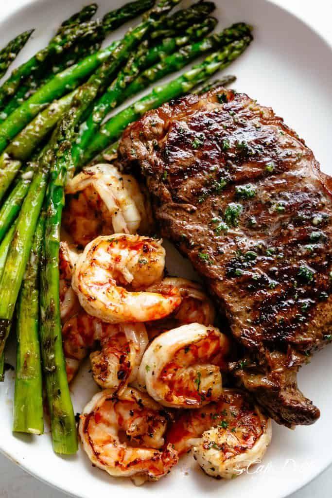 Steak & Shrimp slathered in garlic butter makes for the BEST steak recipe! | cafedelites.com #beefsteakrecipe