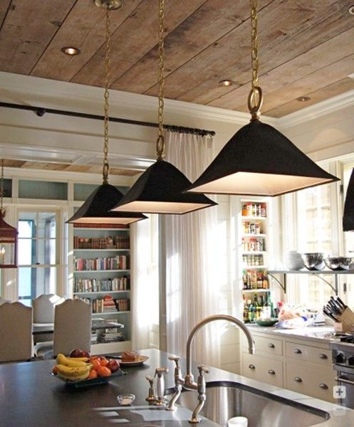 Bookshelves, black pendant lights, reclaimed wood ceiling.