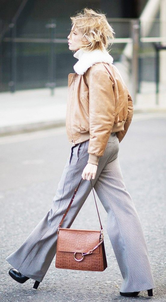Elena Perminova in a fur-collar bomber jacket and plaid trousers