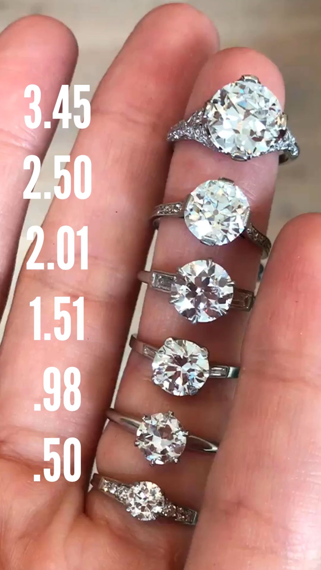 Vintage diamond carat size on a hand featuring Erstwhile