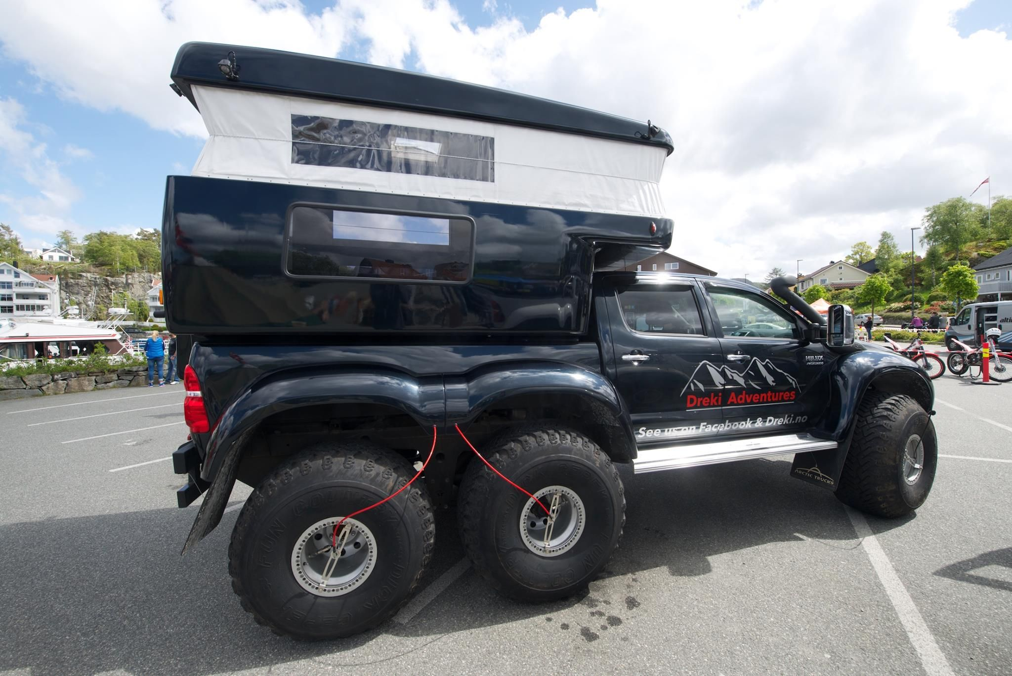Toyota hi lux arctic trucks conversion with a slide in pop up camper for colder climate owned by dreki adventures iceland and norway made by arctic